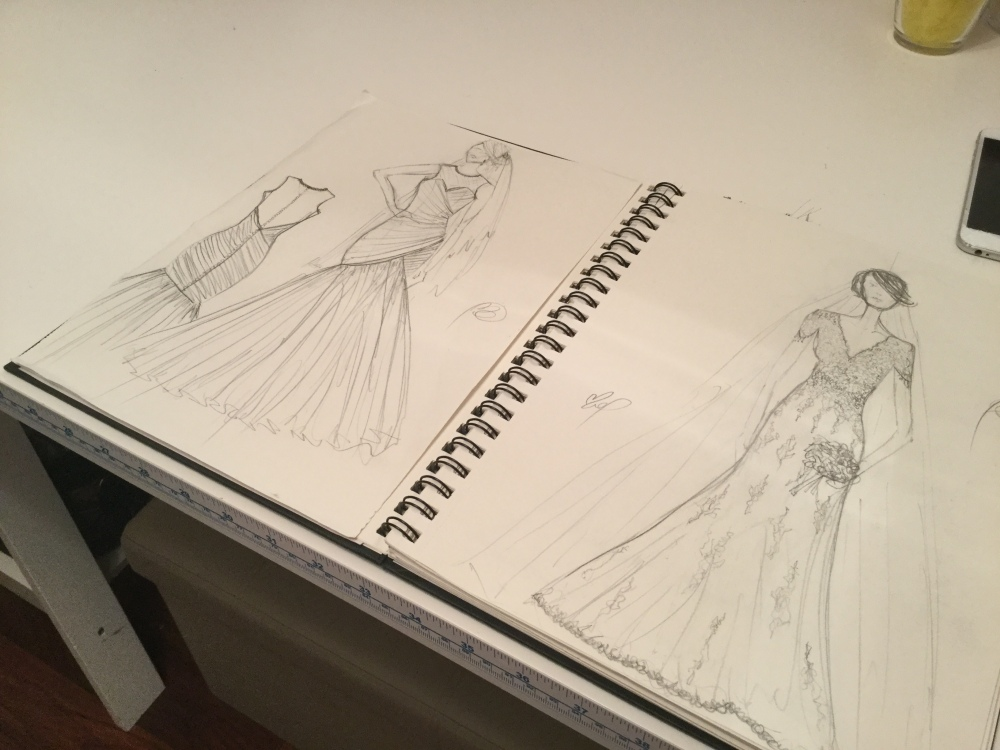 Millie's sketch book with some of the dresses she has designed for herself.